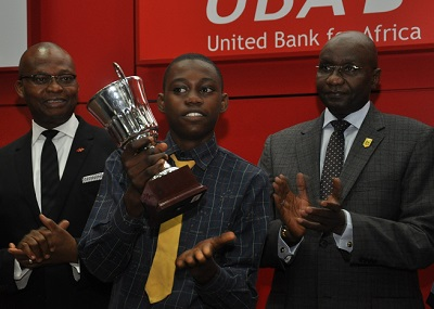 l-r: Mr. Kennedy Uzoka, Deputy Managing Director, UBA Plc,; Master Ezenwa Joseph Okonkwo, 1ST Prize Winner, student of Ambol Comprehensive High School, Akesan-Igando, Lagos (Middle); and Alhaji Alkali Mohammed,  President, Institute of Chartered Accountant of Nigeria (ICAN) at the grand finale ceremony of UBA Foundation National Essay Competition for Secondary School Students held at UBA House, in Lagos on Monday