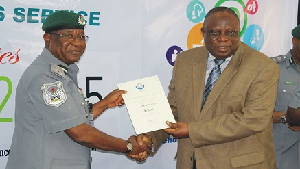 L-r: Dikko inde Abdullahi, comptroller-general of the Nigerian Customs Services presents the award to  Oluropo Owolabi, managing director \CEO, SAHCOL