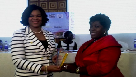 """(L-r): Lynda Saint Nwafor, CTO, MTN Nigeria, receiving """"Best Supporter of the Year"""" award from Ufuoma Emuophedaro, editor-in-chief and convener, Girls in ICT (Nigeria), at Girls in ICT Day 2015 held in Lagos during the week."""