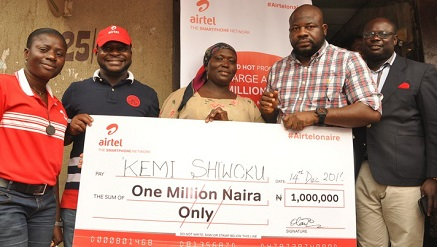 (L-r): Deborah Steve-Kolawole, area sales manager, Lagos Island; Chukwuemeka Adigwe, regional marketing manager, Lagos region; Kemi Shiwoku, Red Hot Promo winner; Oladokun Oye, regional operations director, Lagos Region, and Alex Ute, Zonal Business Manager, Lagos Coastline Zone, AirtelNigeria, during a prize presentation at Lagos Island on Wednesday.
