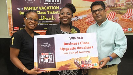 (L-): Fola Akinboro, Etihad Airways Marketing Lead, Nigeria, congratulates Mrs. Fola Otuyelu while John Goldsmith, head of Marketing, Artee Group, also join at the grand prize winner presentation in Lagos