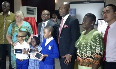 (L-r): Chukwuemeka Agbata, media entrepreneur and founder CFA Tech; Mrs. Ailsa Griffiths, head teacher, St. Saviour's School; Adebayo Adesina, zonal head of Commercial Banking Division - Island Zone and Deputy General Manager, Access Bank Plc; Leo Stan Ekeh, chairman, Zinox Group; Mrs. Bisi Olaleye, ICT Correspondent, The Sun Newspapers, and Mr. Kyle, general manager of Western African Region, Shenzhen Kstar Science & Technology Co. Ltd, along with pupils from invited schools displaying the new Kids Legacy